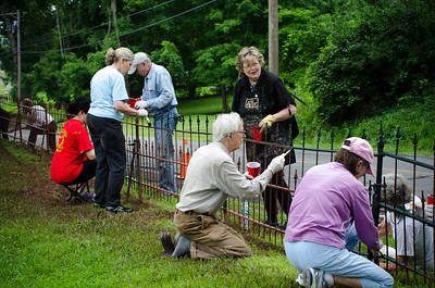 1307_volunteers paint fence_001