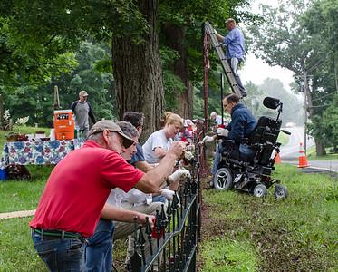 1307_volunteers paint fence_008