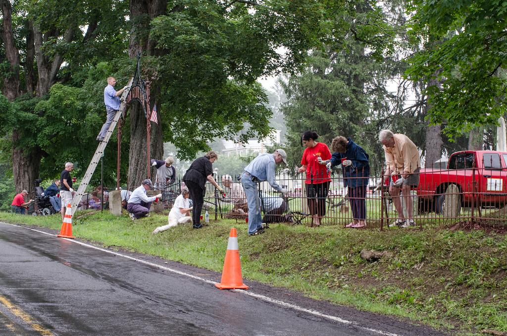 1307_volunteers paint fence_028