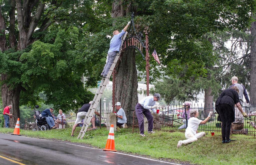 1307_volunteers paint fence_026