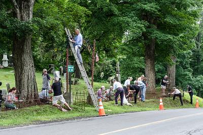 1307_volunteers paint fence_004