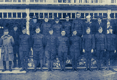Men in uniform in front of porch