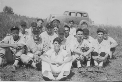 baseball team with car in the background