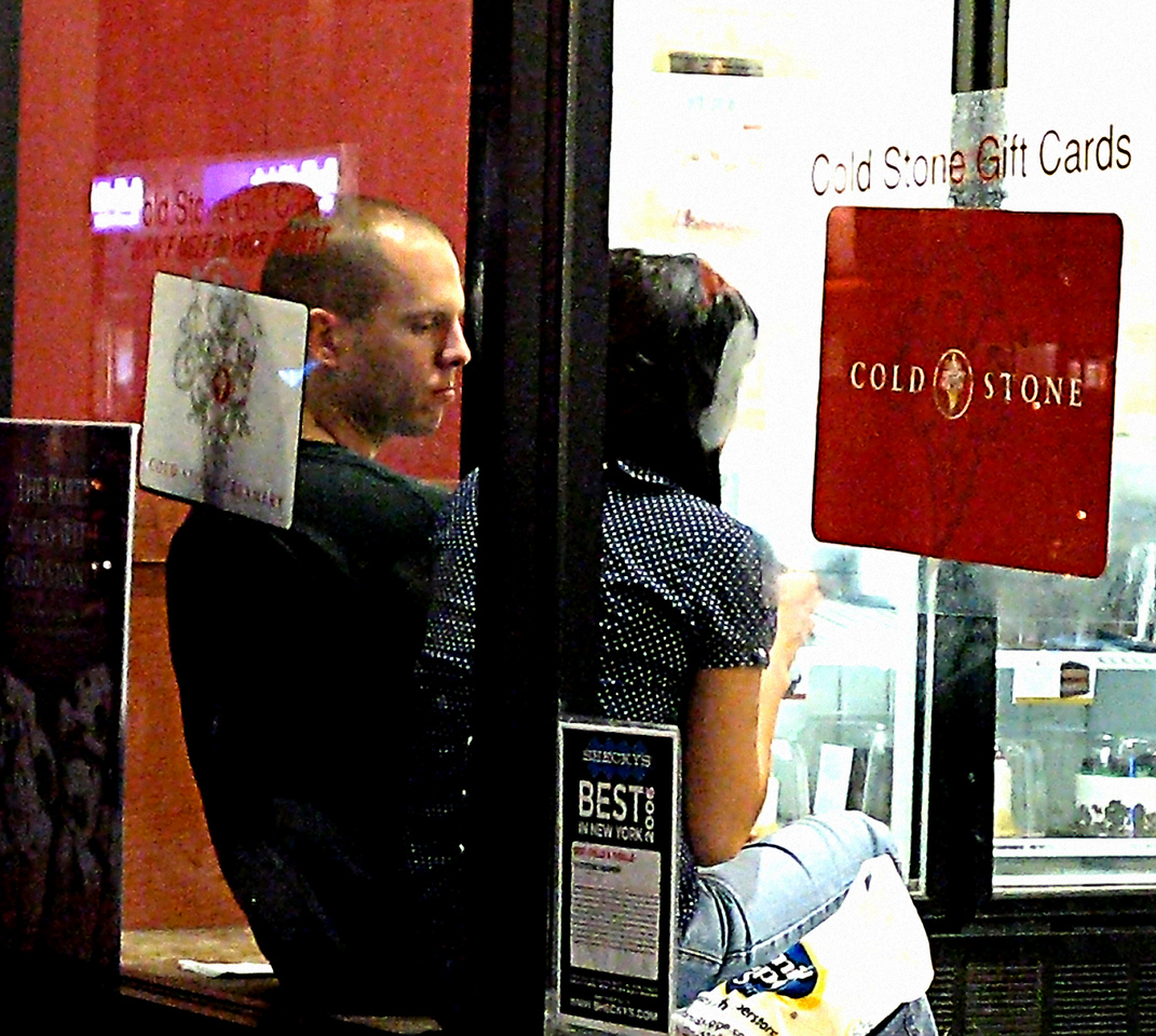 Couple in window 3200 ISO