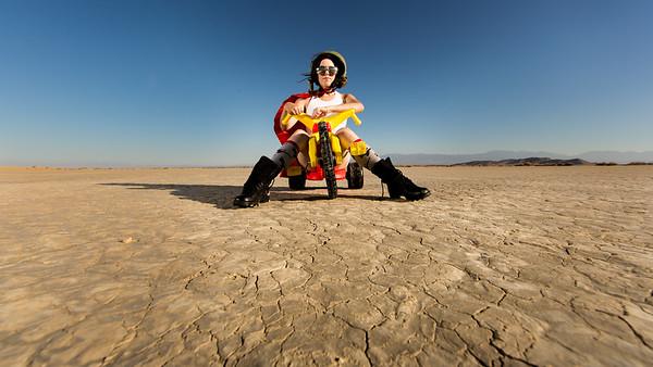 Disabled model Alanna Flax-Clark in El Mirage desert salt flats on a big wheel.