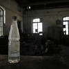 Forgotten bottle in an abandoned warehouse in Sulina shipyard, in 2006