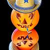 Orange plastic pumpkin with a cowboy hat