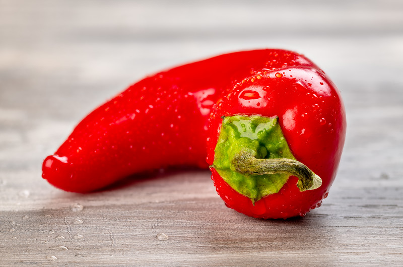 Close up of a red-hot pepper with water on it