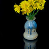A bunch of Yellow Daises in a hamndmade vase