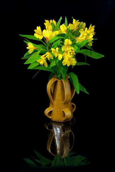 Handmade Vase holding a bunch of fresh flowers