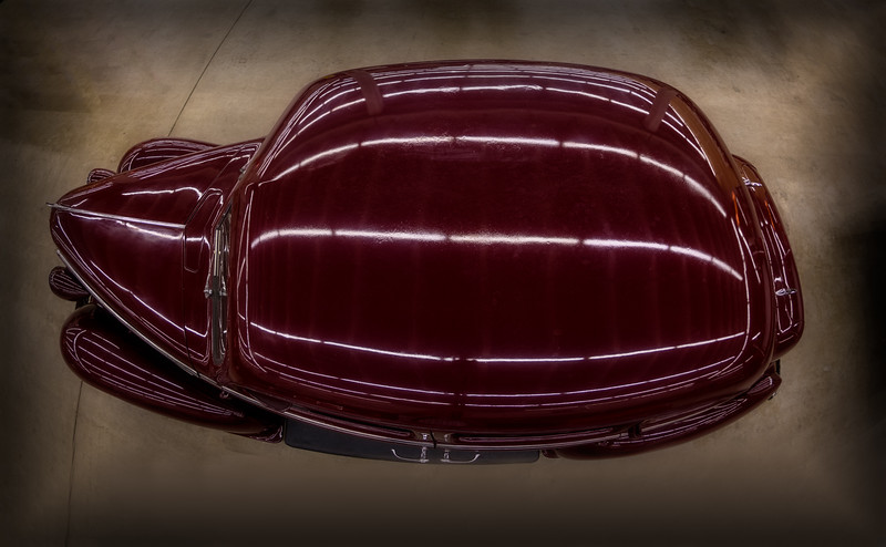 Aerial view of a dark red antique car from the Yankee Car Museum