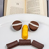 Chapter eleven and snack cakes in teh shape of a sad face