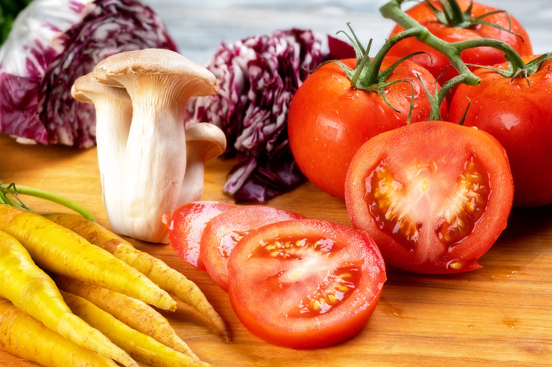 Close up of fresh vegetables with tomatoes, mushrooms, and carrots