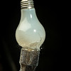 last of the incandescent light bulbs finds its fate on the business end of a hammer