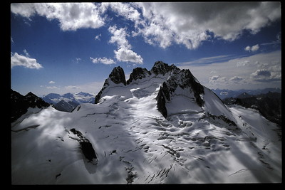 Howser Towers from Bugaboo Spire during retreat ahead of incoming storm