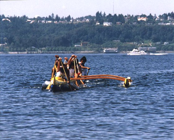 First set of practices for Kikaha O Ke Kai, 1997. We were founded in 1996  with first races in 1997, including an epic Gorge race. Here is our first 450lb Malia canoe off Browns Point. Note the tall paddles.