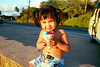 Amber loves Matzamoto Shave Ice, 2002. This was taken in Halewa while watching the North Shore Wahine practice for Molokai. See the sunset paddling picture earlier in the gallery.
