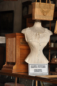 Advancement topic:  Interiors Glove Fitting Corsets...of course, is there any other kind? Old time store display, Virginia City, Montana. 7.09 Score: 8.25.  comments or suggestions:  crop on left side or darken the white area on the left side, debate on whether or not to crop off bottom display case..