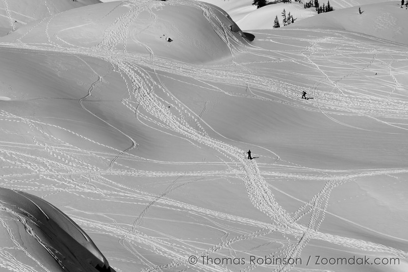 The paths of snowshoers, skiers, and snowboarders form an abstract design near Artist Point.
