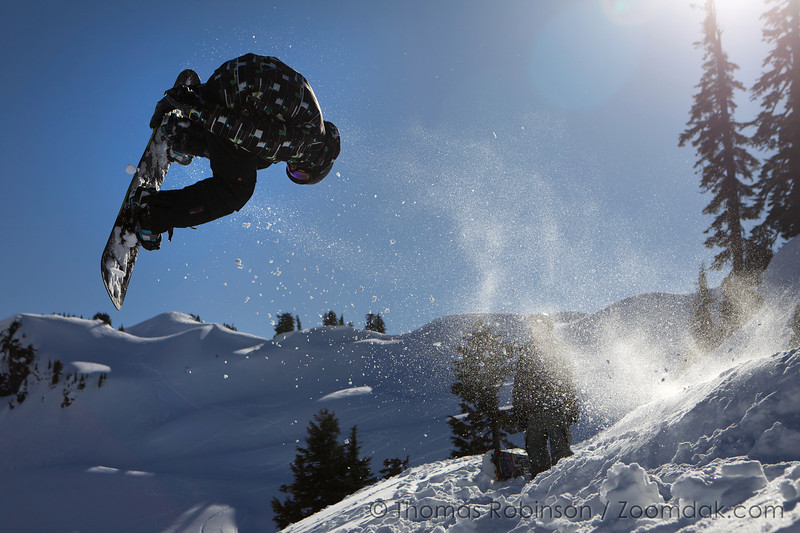 Luke Wyman flips off a snowboard jump near Artist Point in Washington.