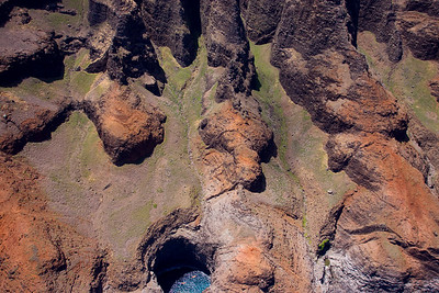 Two kayaks in the lava tube hole.