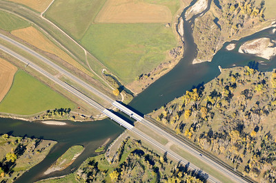 Aerial Photo of The Jefferson River flowing under Highway I-90 before the convergence of The Madison River and Gallatin River converge in Three Forks Montana to form the Missouri River in Montana