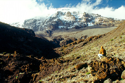 Climber contemplating Kilimanjaro from Karanga Valley
