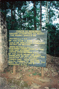 Remember, acclimate slowly, sign at base of Marangu Route, Mount Kilimanjaro