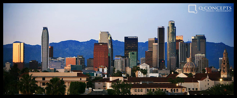 The downtown Los Angeles skyline at dusk on a rare clear day.