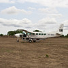 Cessna Caravan on the runway in Akobo, Jonglei State, South Sudan. The photo is taken a few minutes before it started to rain. As there is black cotton soil it means everyone have only a few minutes to run to the plane so we can take off. After 5 minutes of rain it would be impossible for the plane to take off due to the soil becoming too muddy. This photo was taken during an assessment in the rainy season.