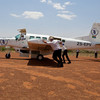 Crew and passenger help to turn the PAC-750 on the apron in Bor, Jonglei State, South Sudan. With so little space turning by engine power would sometimes endanger other planes.