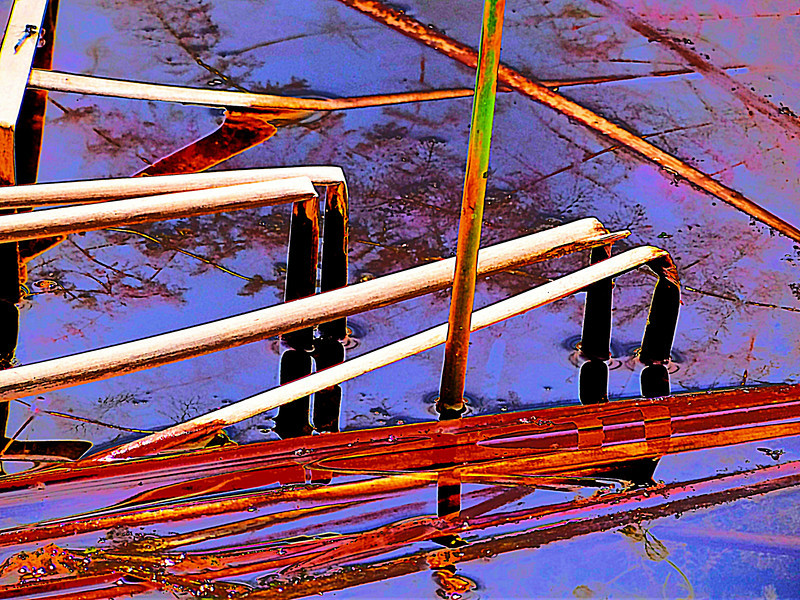 Bent water reeds abstract with blue background, original photo was shot at Glacier Ridge Metro Park outside Dublin, Ohio.