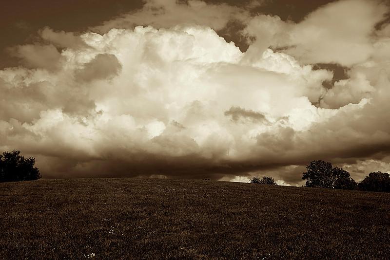 Clouds over Burbank Park in Upper Arlington, Ohio in sepia