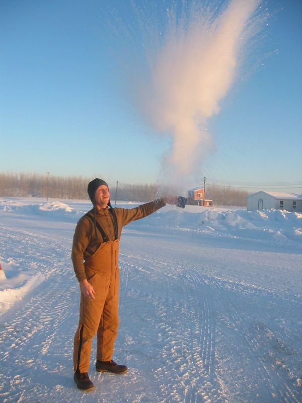 Boiling water at -50.  It explodes and freezes before it hits the ground.