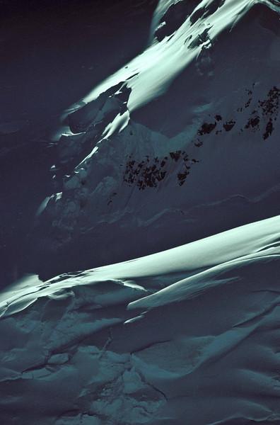 Shadowy glacier forms on Denali.<br /> Photo © Carl Clark