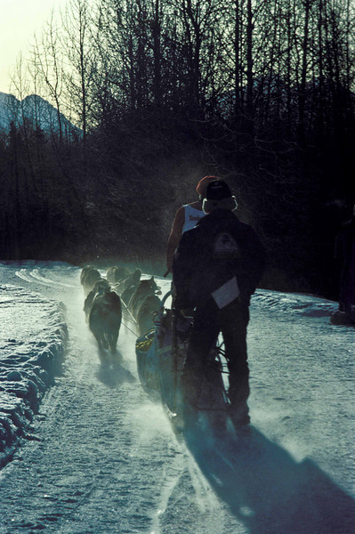 Iditarod mushers on the trail to Nome.<br /> Photo © Carl Clark