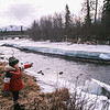 My youngest daughter points out ice thickness at Ship Creek, near Anchorage, Alaska, not far from our home at Elmendorf AFB.