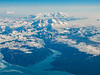 Mt St. Elias and Mt Logan above the blue water of Icy Bay.<br /> Photo © Carl Clark