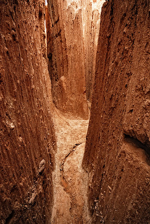 A slot canyon made of mud. The walls tower anywhere from 80 - 100 feet.They call this the cave. The temperature drops about 20 degrees Fahrenheit inside.