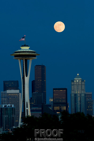 Full Moon Rises Above Seattle's Cityscape