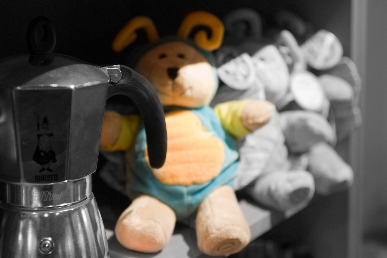 """026. 15 December 2008 - Bears<br /> <br /> I actually took this while waiting for a Venti Cappuccino at the local Starbucks, but was annoyed by the fact that the first bear, the intended subject was not the core focus, rather the handle of the coffee can was.<br /> <br /> Inspired by Verbeasts' recent escapade into selective colors, I thought I would give it a try... with a twist. To bring the focus back to the intended subject.<br /> <br /> Don't know how well it worked out, not entirely displeased myself, but you be the judge. Remember, I am learning a ton of stuff doing the dailies and any suggestions and comments are welcomed.<br /> <br /> UPDATE: I didn't consider that there were others searching for the knowledge to achieve this. I've add the link below that I found, but did my own thing half way through. I'm using Photoshop CS4 now, but if memory serves, the older versions also had the different types of adjustment layers. Instead of using the Hue/Saturation adjustment layer, I went with the Black and White adjustment layer and also used 80% opacity. Other than that, I was amazed at how easy it really is to achieve such fancy post processing.<br /> <br />  <a href=""""http://www.tipclique.com/tutorial/photoshop/adobe-photoshop-tutorial-selective-color/"""">http://www.tipclique.com/tutorial/photoshop/adobe-photoshop-tutorial-selective-color/</a><br /> <br /> Hope you find it helpful."""