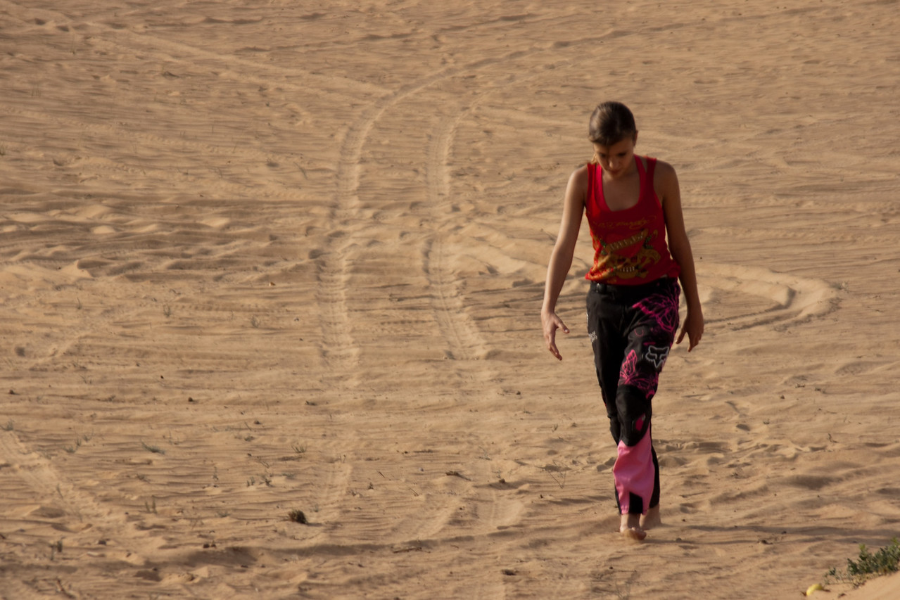 040. 20 January 2008 - The Long Walk<br /> <br /> This is Lanischa, daughter of the Meyers, wandering back from recovering a soccer ball that rolled way down a slow sloping dune in the desert.
