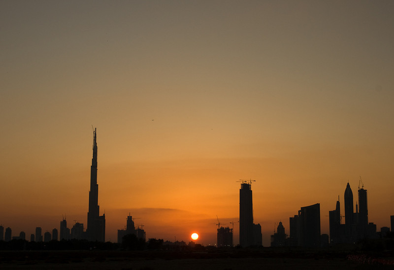 022. 11 December 2008 - Sunset Over The Burj<br /> <br /> Can you guess the times of day I have free to take some pictures during the week? Yip, sunrise and sunset are no stranger to me.<br /> <br /> This one is of the Burj Dubai, the world's tallest building and man-made structure (currently at 688m). In context, you see many of the buildings around the Burj are also under construction, which is a bit of epidemic in Dubai - the whole city is under construction.