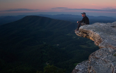 Enjoying the sunset on the edge of the McAfee Knob prow.