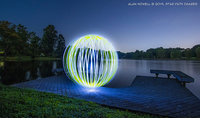 Light orb spinning over the lake.