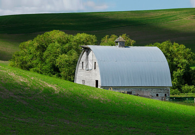 Blue and white barn with light and shadow, Washington