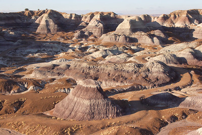 The minerals mixed up in the soil give the impression of a painted desert. The shades are pastel - not Bollywood.