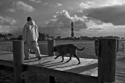 Cape Lookout Lighthouse ferry guide Labrador retriever captain jack boat ride by Alan Howell Star Path Images