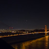 The Golden Gate Bridge at night at high ISO.