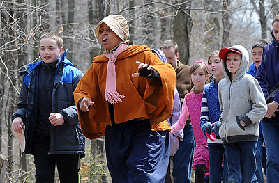 "Lorain County home school students learn about the Underground Railroad on ""Road To Freedom"" program at French Creek Reservation on April 13.  Students walked through the park as runaway slaves on the journey to freedom with the help of reenactor portrayals . STEVE MANHEIM/CHRONICLE"